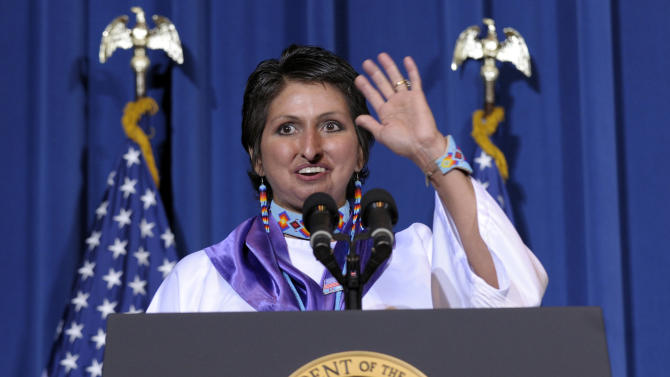 Diane Millich, a member of the Southern Ute Indian Tribe in Colorado and domestic abuse survivor introduces, Vice President Joe Biden at the Interior Department in Washington, Thursday, March 7, 2013, before President Barack Obama signed the Violence Against Women Act. (AP Photo/Susan Walsh)