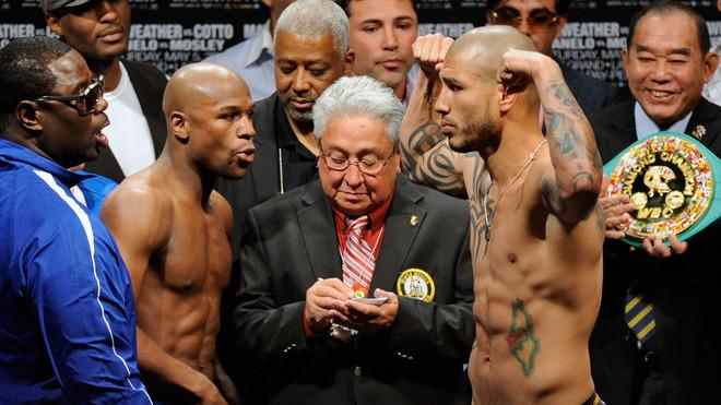 WBA Super Welterweight Champion Miguel Cotto (R) Poses Getty Images