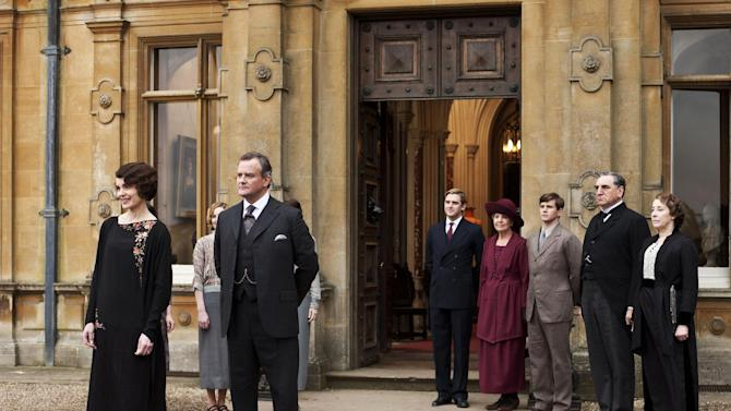 "This undated publicity photo provided by PBS shows, from left, Elizabeth McGovern as Lady Grantham, Hugh Bonneville as Lord Grantham, Dan Stevens as Matthew Crawley, Penelope Wilton as Isobel Crawley, Allen Leech as Tom Branson, Jim Carter as Mr. Carson, and Phyllis Logan as Mrs. Hughes, from the TV series, ""Downton Abbey.""  The third season premiere airs in the U.S. on Sunday, Jan. 6, 2013 on PBS. (AP Photo/PBS, Carnival Film & Television Limited 2012 for MASTERPIECE, Nick Briggs)"
