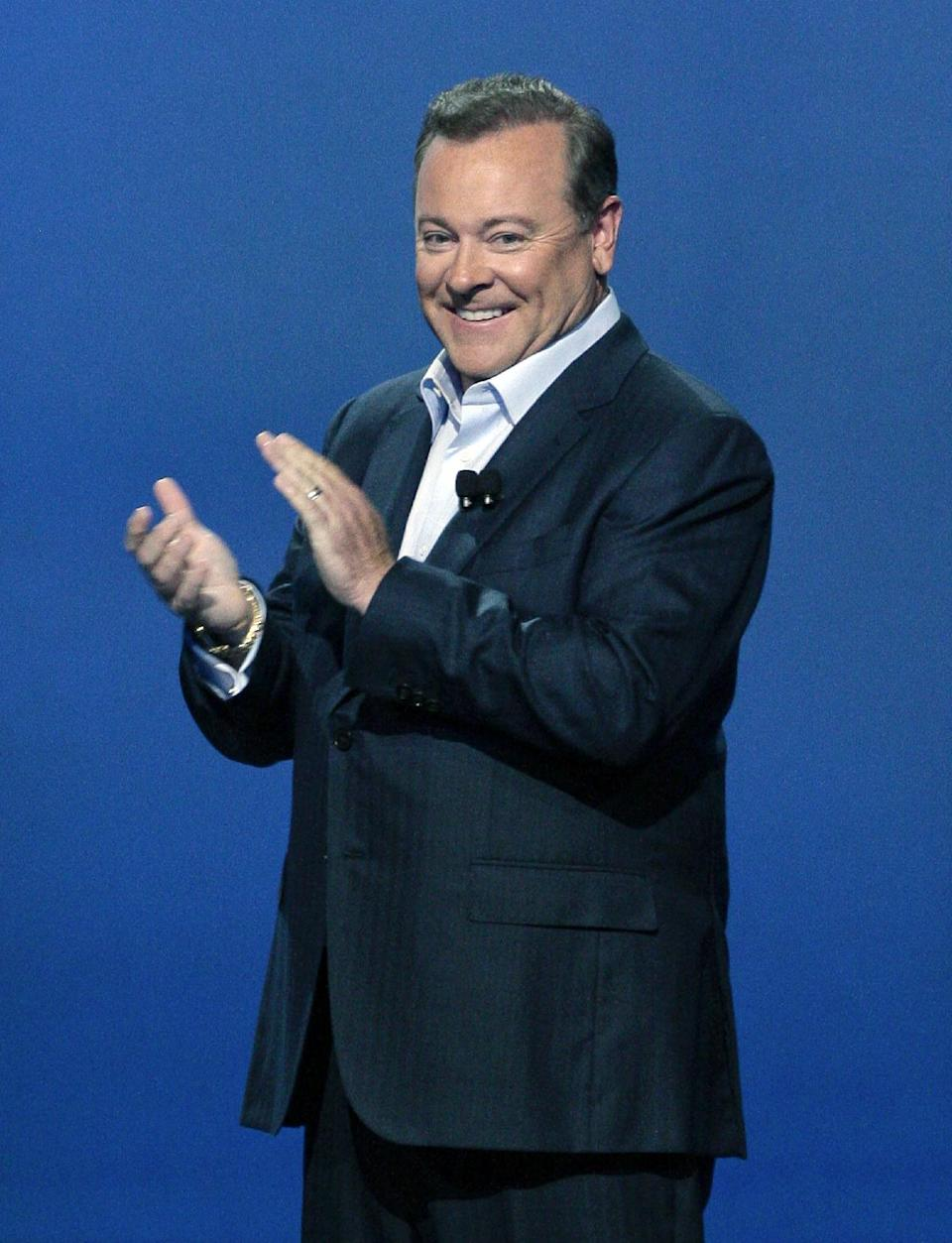 Jack Tretton, President and CEO of Sony Computer Entertainment America, applauds during the Sony Electronic Entertainment Expo (E3) news conference in Los Angeles, Monday, June 4, 2012. (AP Photo/Jason Redmond)