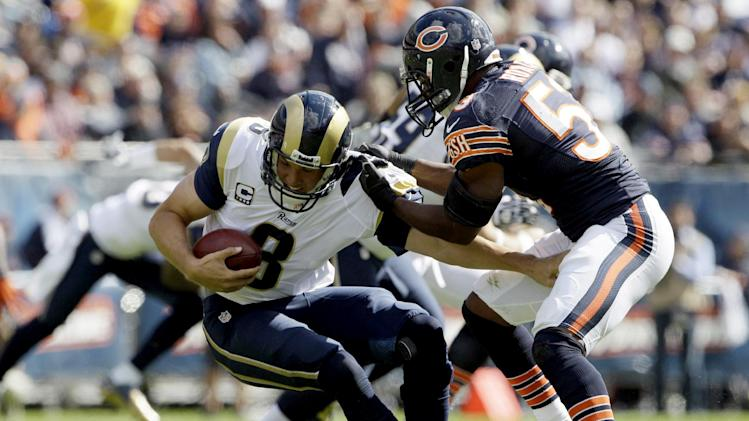 St. Louis Rams quarterback Sam Bradford (8) is sacked by Chicago Bears linebacker Nick Roach (53) in the second half of an NFL football game in Chicago, Sunday, Sept. 23, 2012. The Bears won 23-6. (AP Photo/Nam Y. Huh)