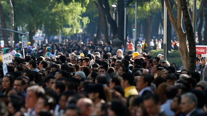 People crowd the street during an earthquake evacuation drill in Mexico City