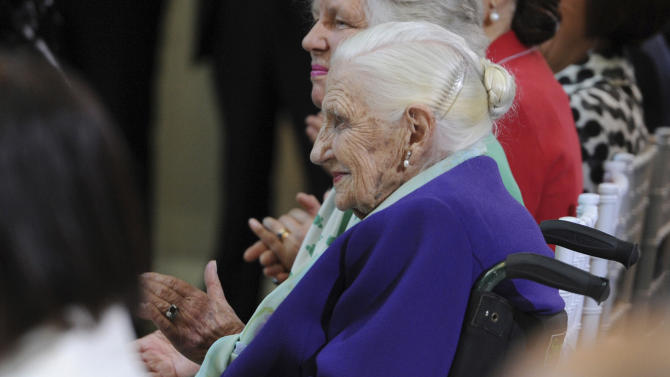 FILE - In a Oct. 26, 2011 file photo, Dame Elisabeth Murdoch sits in the audience as Queen Elizabeth II visits the Royal Children's Hospital in Melbourne. Dame Elisabeth Murdoch, a prominent Australian philanthropist and mother of media mogul Rupert Murdoch, died late Wednesday, Dec. 5, 2012 in Melbourne, according to News Ltd., the Australian media company headed by her son. She was 103. (AP Photo/Julian Smith, Pool, File)