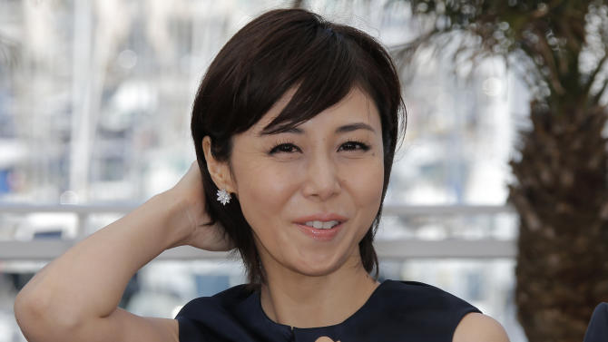 Actress Nanako Matsushima poses for photographers during a photo call for the film Shield of Straw at the 66th international film festival, in Cannes, southern France, Monday, May 20, 2013. (AP Photo/Lionel Cironneau)