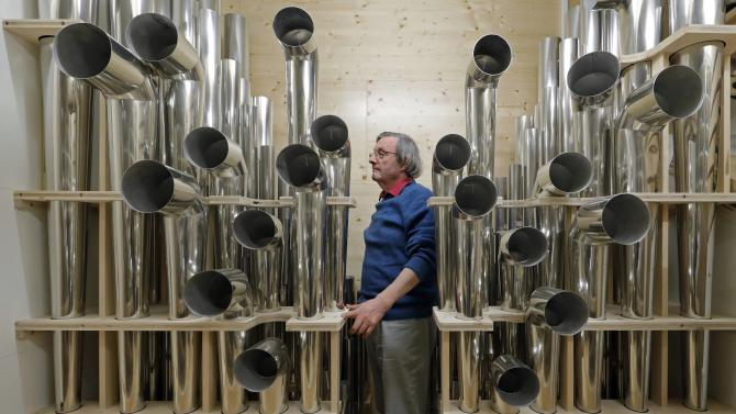 Michel Garnier, renowned harmonist, is seen among the pipes of the new Rieger organ at the Paris Philharmonic Hall in Paris