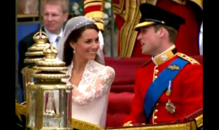 AP Photo: William and Kate travel by carriage after the wedding ceremony.