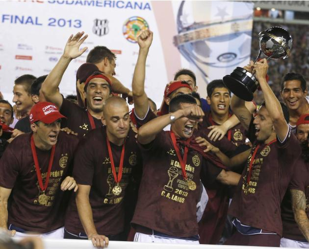 Argentina's Lanus soccer team poses with trophy after defeating Brazil's Ponte Preta in final Copa Sudamericana match in Buenos Aires