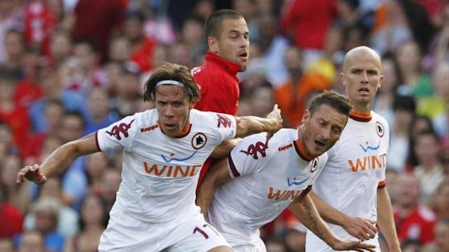 Roma's Rodrigo Taddei competes with Liverpool's Joe Cole along with Francesco Totti, as Michael Bradley looks on (Reuters)
