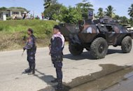 This file photo shows policemen standing guard in Davao, on April 3, 2003. A man with alleged ties to Islamic militants was shot dead in Davao after he threatened to set off a backpack bomb in a stand-off with local police, an official said on Saturday