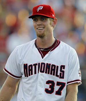 Washington Nationals pitcher Stephen Strasburg smiles after finishing the second inning for the Class-A Potomac Nationals during a baseball game against the Myrtle Beach Pelicans, Friday, Aug. 12, 2011, in Woodbridge, Va. Strasburg made his second rehabilitation start since undergoing Tommy John surgery Sept. 3, 2010. (AP Photo/Luis M. Alvarez)
