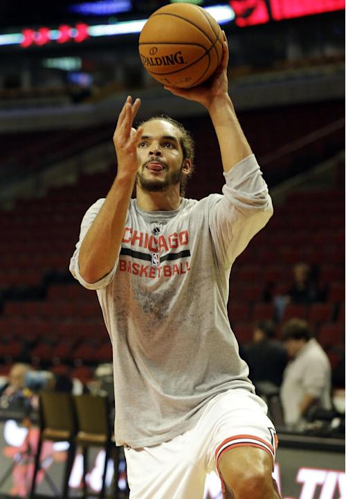 Chicago Bulls' Joakim Noah warms up before an NBA preseason basketball game against the Detroit Pistons in Chicago on Wednesday, Oct. 16, 2013