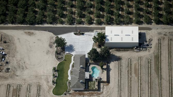 Farm with a lawn and a swimming pool is seen in the Central Valley near Fresno