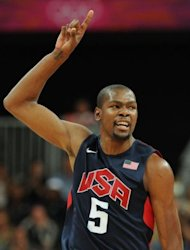 US forward Kevin Durant reacts during the men&#39;s basketball preliminary round match Argentina vs USA as part of the London 2012 Olympic Games at the Basketball Arena in London. USA defeated Argentina 126-97