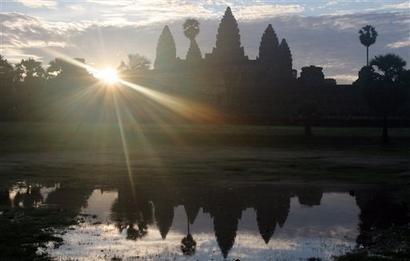 Morning clouds hang over the towers of the legendary Angkor Wat temple north of