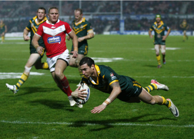 Australia's Darius Boyd, right, dives over to score a try against Wales during their four nations rugby league test match at the Racecourse Ground, Wrexham, Wales, Sunday Nov. 13, 2011. (AP Photo/Tim