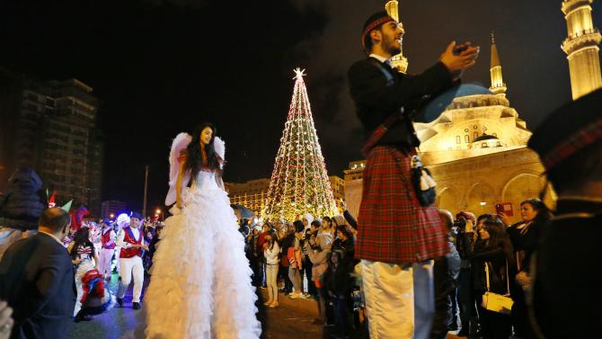 Dancers celebrate in a parade during a Christmas tree lighting in downtown Beirut