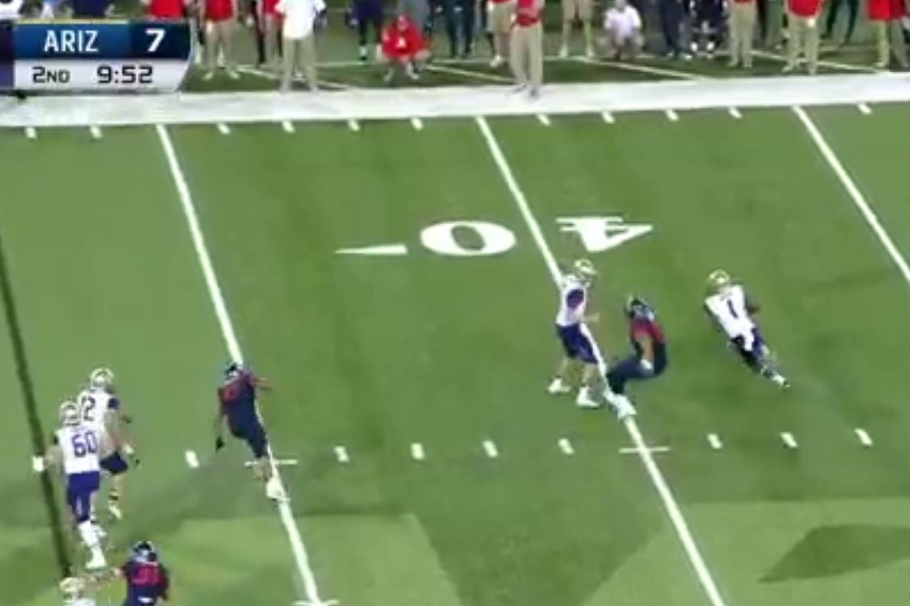 The Washington Huskies' QB had to block, so he laid out an Arizona defender