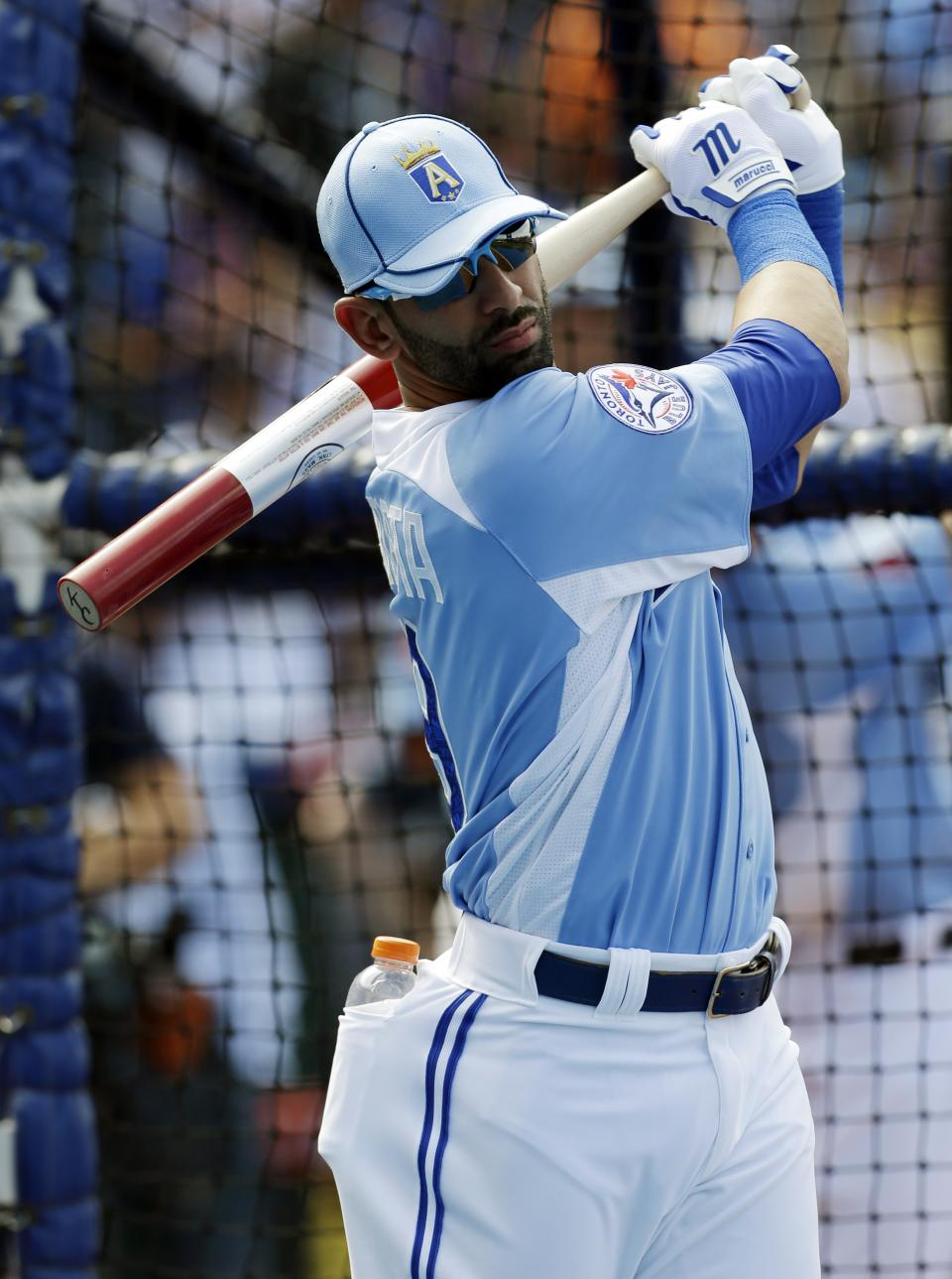 American League's Jose Bautista, of the Toronto Blue Jays, warms up during MLB All-Star baseball batting practice, Monday, July 9, 2012, in Kansas City, Mo. (AP Photo/Jeff Roberson)