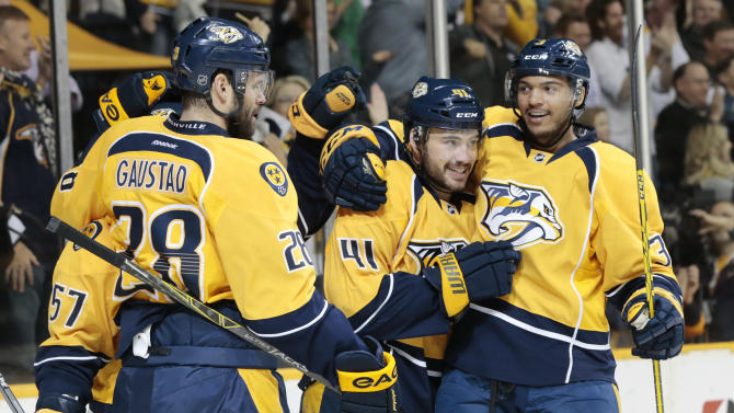 Nashville Predators left wing Taylor Beck (41) is congratulated by Seth Jones, right, after Beck scored a goal against the Vancouver Canucks in the first period of an NHL hockey game Tuesday, March 31, 2015, in Nashville, Tenn. (AP Photo/Mark Humphrey)