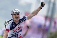 Stage winner, Germany&#39;s Andre Greipel celebrates on the finish line at the end of the 214.5 km and fourth stage of the 2012 Tour de France cycling race starting in Abbeville and finishing in Rouen, northwestern France