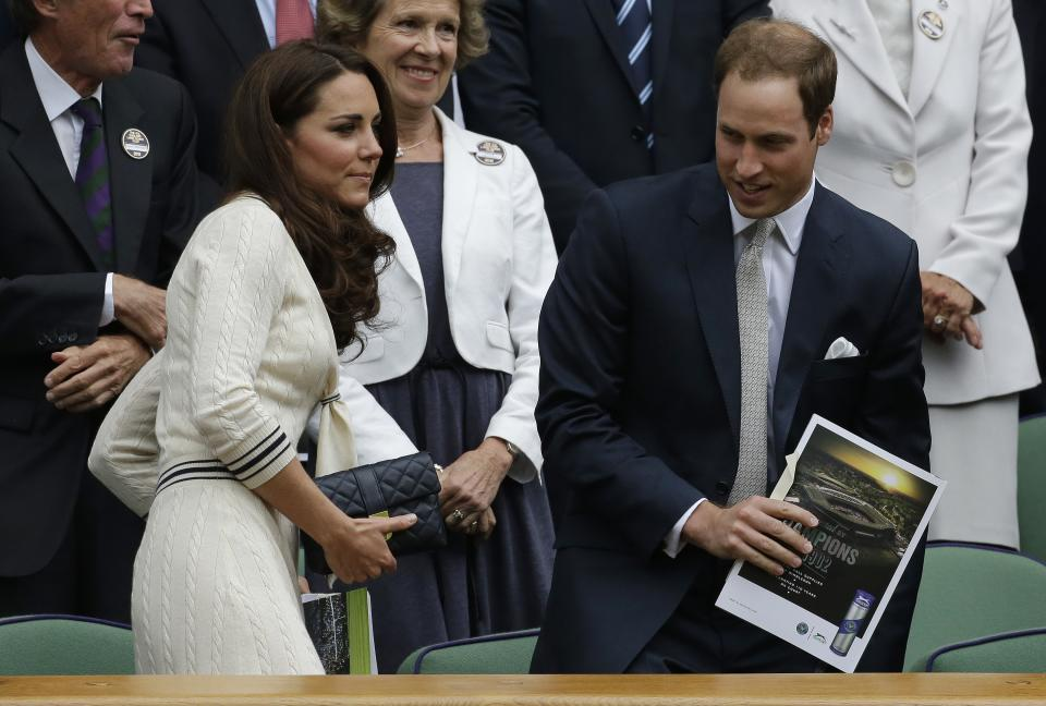Britain's Prince William, right, and his wife Kate, Duchess of Cambridge, left, arrive ahead of a quarterfinals match between Roger Federer of Switzerland and Mikhail Youzhny of Russia at the All England Lawn Tennis Championships at Wimbledon, England, Wednesday July 4, 2012. (AP Photo/Anja Niedringhaus)