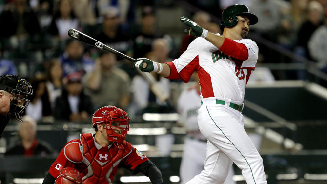 Mexico's Adrian Gonzalez hits an RBI single during the first inning of a World Baseball Classic baseball game against Canada, Saturday, March 9, 2013, in Phoenix. (AP Photo/Matt York)