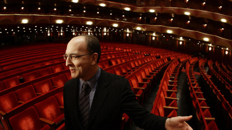 FILE - In this file photo of Jan. 9, 2008, Metropolitan Opera general manager Peter Gelb gestures inside the Metropolitan Opera House in New York. Fractious labor negotiations threaten to disrupt the Met's new season for the first time in more than 30 years. This week, Gelb vowed to lock out union members _ cutting off pay and health insurance _ unless they settle before contracts expire July 31. (AP Photo/Julie Jacobson, File)