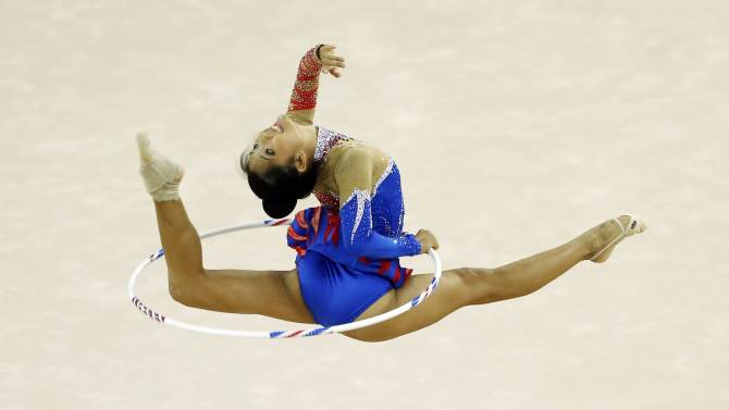 Thailand's Panjarat Prawatyotin performs with the hoop in the individual rhythmic gymnastics qualification and team final at the Namdong Gymnasium Club during the 17th Asian Games in Incheon