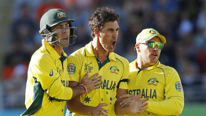 Australia Mitchell Starc celebrates bowling out New Zealand's Grant Elliott during their Cricket World Cup match in Auckland