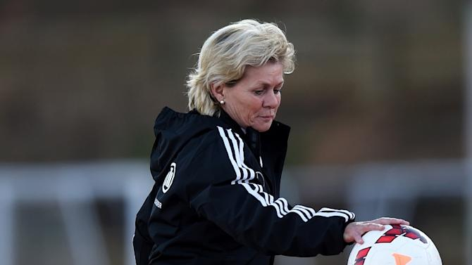 Germany's coach Silvia Neid catches a ball during the Algarve Cup match between Brazil and Germany at the Bela Vista stadium in Parchal on March 9, 2015