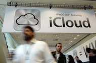 Attendees walk by a sign for the new iCloud during the 2011 Apple World Wide Developers Conference in San Francisco, California. A sold-out Apple gathering devoted to tailoring programs for the company's coveted gadgets will kick off in San Francisco on June 11 with a keynote presentation by top executives