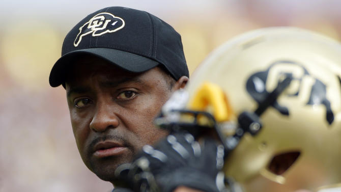 FILE - In this Oct. 20, 2012, file photo, Colorado head coach Jon Embree, left, looks at a player during the first half of their NCAA college football game against Southern California in Los Angeles. With the realignment of conferences the past few years, it often means adjusting to a new style of football for teams that are switching conferences.  There hasn't been much good in Jon Embree's third season as coach, with Colorado at 1-9 overall after joining the Pac-12. (AP Photo/Mark J. Terrill, File)