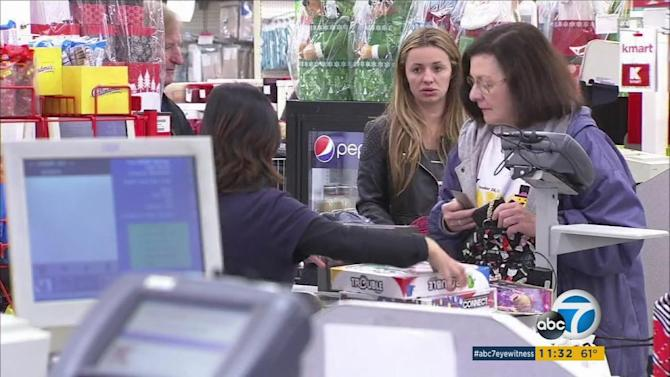 Shoppers head into stores on Thanksgiving for early deals