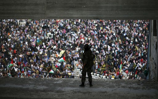 An Islamic Jihad militant stands guard during a rally in Gaza
