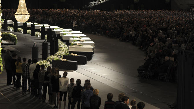 Schoolchildren prepare to take the stage during a memorial service at the Soeverein Arena in Lommel, Belgium on Wednesday, March 21, 2012. Mourners and family members attended a memorial service to honor the victims of a bus crash in the Swiss Alps which killed 22 children and six adults . (AP Photo/Yorick Jansens, Pool)