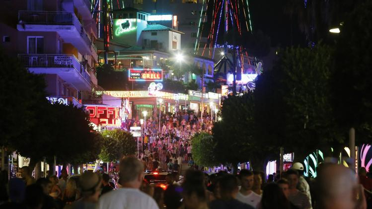Tourists walk at Punta Ballena street in Magaluf, on the Spanish Balearic island of Mallorca