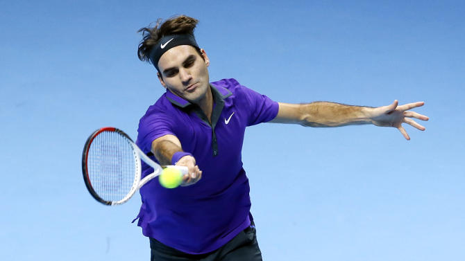Roger Federer of Switzerland plays a return to Juan Martin Del Potro of Argentina, during their singles tennis match at the ATP World Tour Finals in London Saturday, Nov. 10, 2012. (AP Photo/Kirsty Wigglesworth)