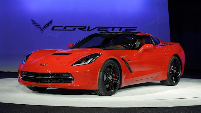FILE - In this Monday, Jan. 14, 2013, file photo, the 2014 Chevrolet Corvette Stingray is revealed at media previews for the North American International Auto Show in Detroit. Maybe it was the brand new, bright red Chevrolet Corvette gleaming in one corner, or the elegant BMW coupe in the other, but car companies were positively giddy this week as the North American International Auto Show opened in Detroit. U.S. new car and truck sales reached a five-year high of 14.5 million in 2012, and many executives and analysts think they'll climb to 15.5 million this year. (AP Photo/Paul Sancya, file)