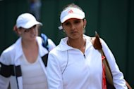 "India's Sania Mirza (shown right at the Wimbledon championships on June 25) has lashed out at the country's tennis chiefs, saying she was humiliated at being used as ""bait"" in an Olympic selection row to pacify a disgruntled Leander Paes. Mirza accused chiefs of ""male chauvinism"""