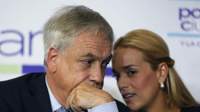 Former president Sebastian Pinera from Chile and Lilian Tintori, wife of jailed opposition leader Leopoldo Lopez, speak during a meeting in Caracas