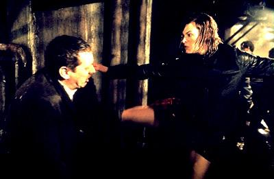 Milla Jovovich as Alice kicking the Un-Dead in Screen Gems' Resident Evil
