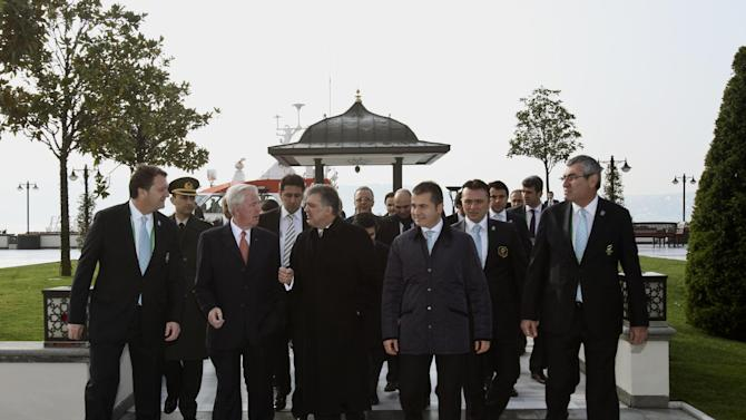 In this Sunday, March 24, 2013  photo provided by Istanbul 202 Media Team Turkey's President Abdullah Gul, third left, speaks with International Olympic Committee, IOC Vice President and chairman of the IOC Evaluation Commission Craig Reedie, second left, as they arrive for the opening of the evaluation commission meeting in Istanbul, Turkey. The IOC Evaluation Commission is in Istanbul to evaluate the city's bid to host the 2020 Olympic Games. (AP Photo/Istanbul 202 Media Team)