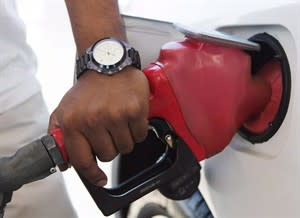 A motorist pumps fuel in Toronto after gasoline prices hike on September 12, 2012. THE CANADIAN PRESS/Michelle Siu