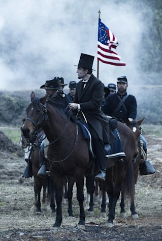 "This undated publicity photo provided by DreamWorks and Twentieth Century Fox shows Daniel Day-Lewis as President Abraham Lincoln looking across a battlefield in the aftermath of a terrible siege in this scene from director Steven Spielberg's drama ""Lincoln"" from DreamWorks Pictures and Twentieth Century Fox. ""Lincoln"" star Daniel Day-Lewis is expected to earn his third Oscar in the title role, making him only the sixth performer to win three or more Oscars and the first to win three times in the best-actor category. (AP Photo/DreamWorks, Twentieth Century Fox, David James, File)"