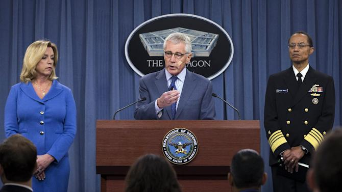 Defense Secretary Chuck Hagel, flanked by Air Force Secretary Deborah Lee James, left, and U.S. Strategic Command Commander Adm. Cecil D. Haney, speaks during a news conference at the Pentagon, Friday, Nov. 14, 2014, where he announced that he is ordering top-to-bottom changes in how the nation's nuclear arsenal is managed, vowing to invest billions of dollars more to fix what ails a force beset by leadership lapses, security flaws and sagging morale. (AP Photo/Evan Vucci)