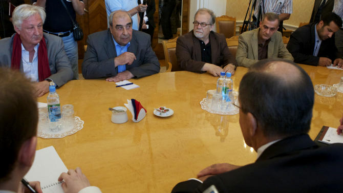 Michel Kilo, a Syrian opposition leader and writer, second left, and other unidentified members of a delegation meet with Russian Foreign minister Sergey Lavrov, foreground right, in Moscow,  Russia, Monday, July 9, 2012. A delegation of Syrian opposition figures led by Kilo visited Moscow for talks about the ongoing conflict in the Middle Eastern nation.(AP Photo/Alexander Zemlianichenko)