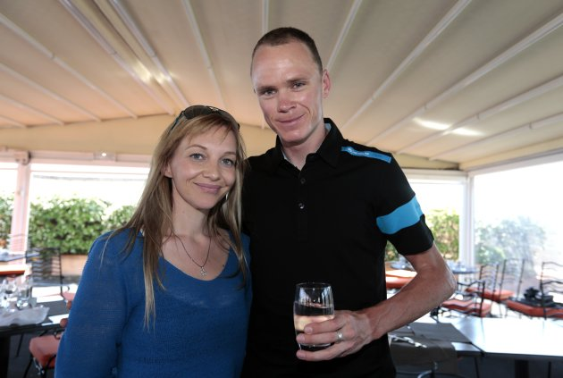 British cyclist Christopher Froome of team Sky poses with his girlfriend Michelle Cound during an interview in Nice