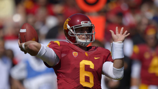 Strong defense leads Trojans past Aggies 17-14
