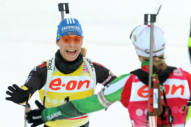 Belarus's Darya Domracheva (R) Kisses AFP/Getty Images