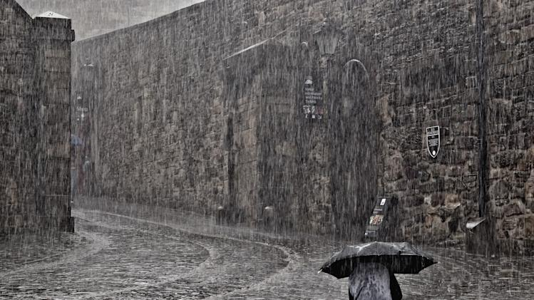 'Light Rain in Edinburgh', Edinburgh, Scotland: Bill Terrance photographed one hardy soul out in a downpour as others hid inside. His picture was the Urban View category runner-up. (Bill Terrance, Landscape Photographer of the Year)
